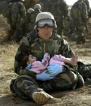 Iraqi Soldier Holding Iraqi Child
