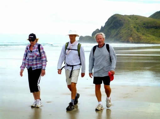 Alma, John and Tom on the long stretch of Te Werahi. It's warming up!